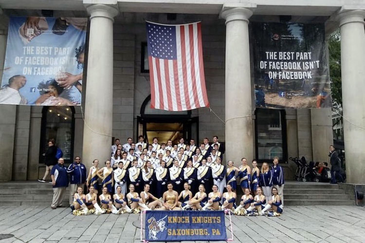 The+marching+band+poses+for+a+picture+following+their+performance+at+Faneuil+Hall.