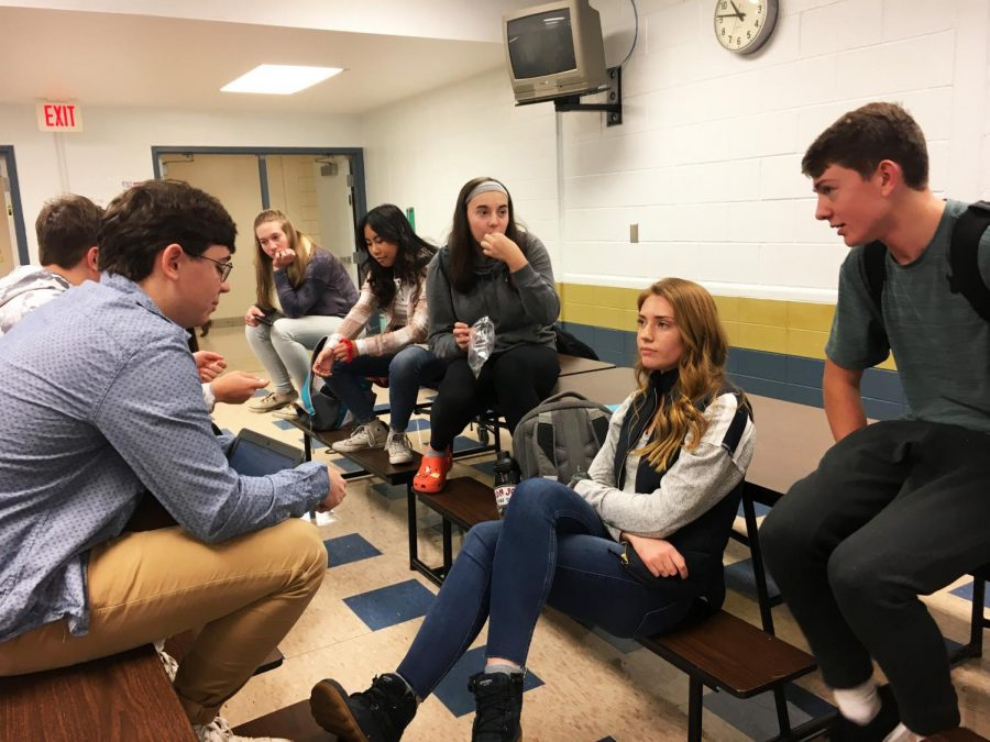 """Knoch Sozo's Marketing team organizes the Sozo Christmas Party in the senior café on December 5th. Huckleberry Finn, head of the marketing team, tried desperately to get the attention of juniors Madison Gumto, Jake Scheidt, Bekah Hortert, Jadyn Brown, and Shaney Enck. Hortert tries to hastily eat her pretzel thins before they are stolen again. When food is brought up, freshman Angelo Deleonardis mentions Italian cuisine. Huck, being the mediator, announces, """"The Italian wants his Spaghetti""""."""