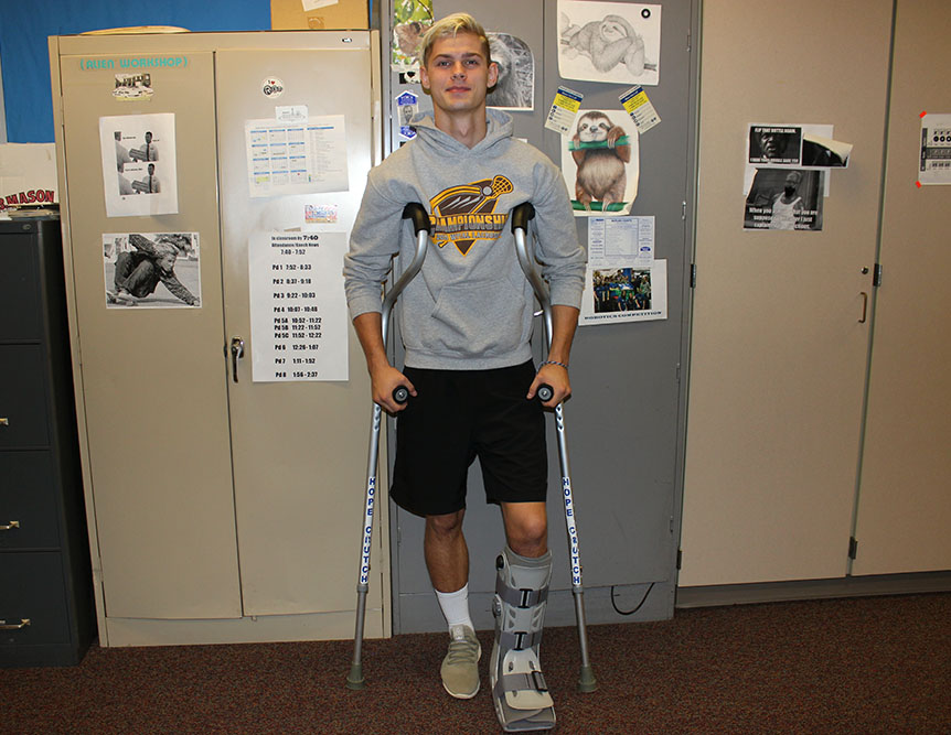 Senior+James+Johnston+is+one+of+many+students+that+can+be+seen+walking+the+halls+with+the+aide+of+crutches.+